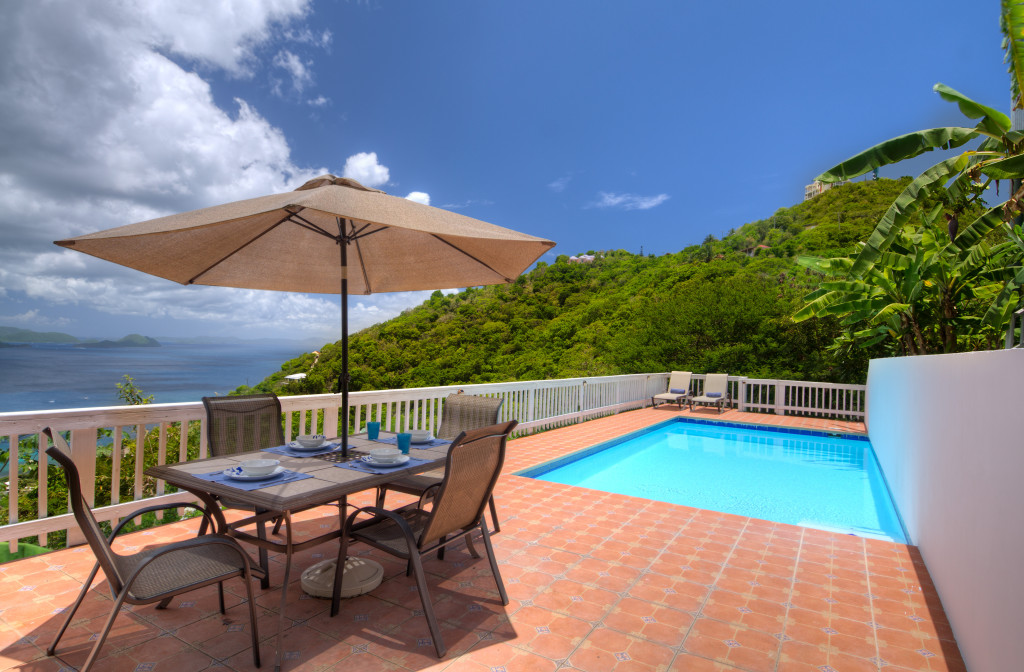 9. Makere House Cottage sun terrace and 25 x 12 ft swimming pool with ocean view